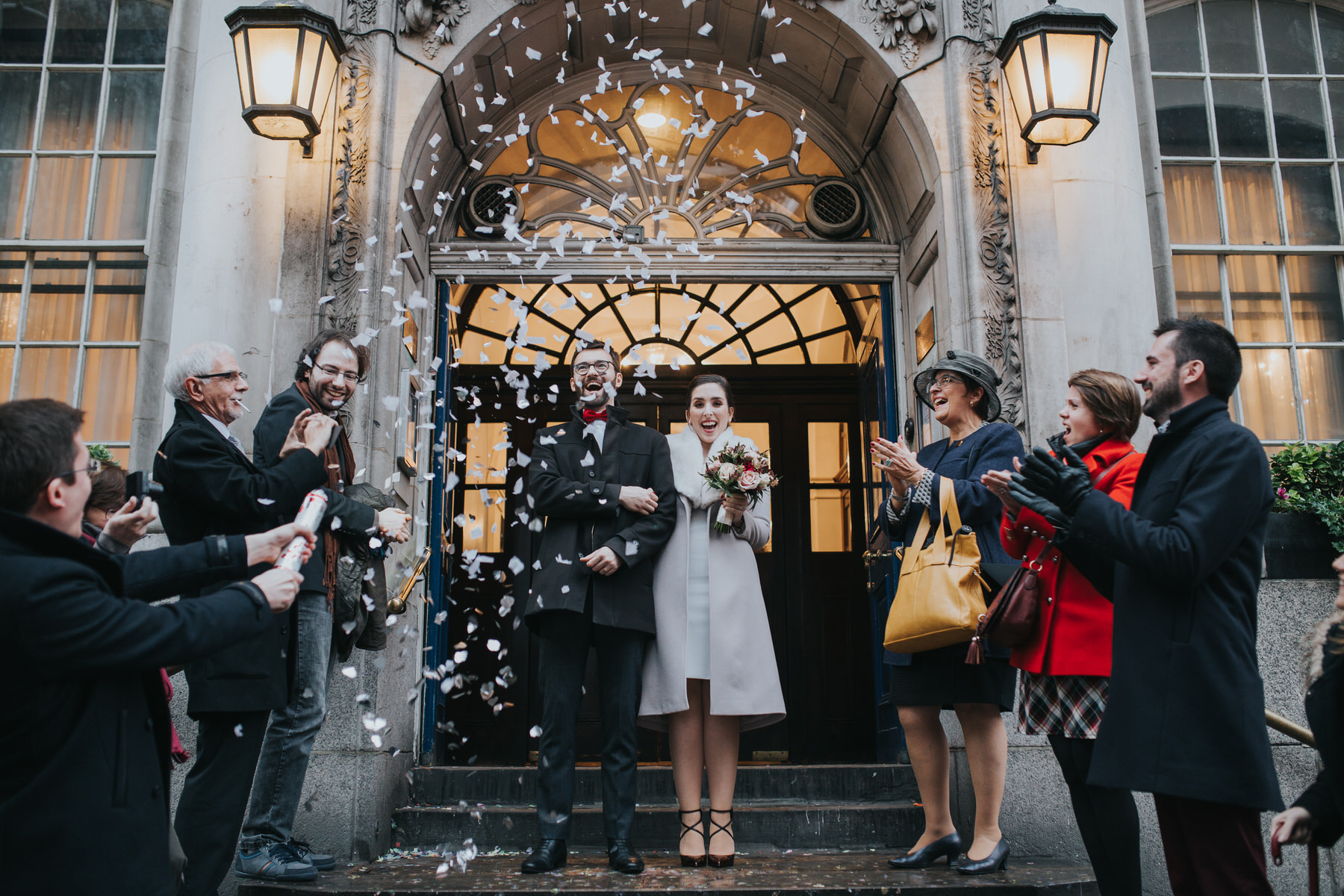 Confetti outside Chelsea Registry Office Kings Road London wedding photographer.jpg