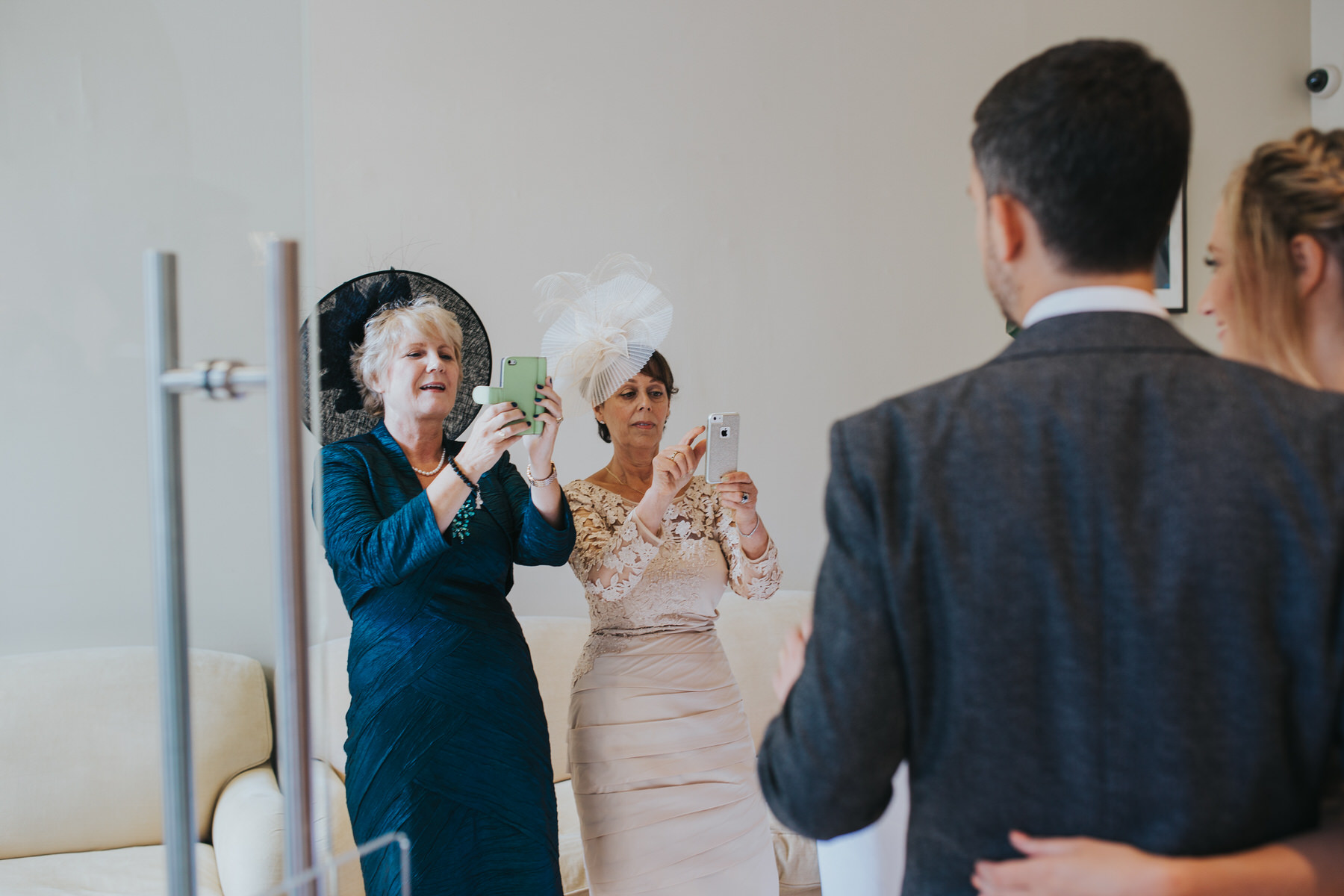 grooms mum brides mother taking photos on phones Asia House wedding London.jpg
