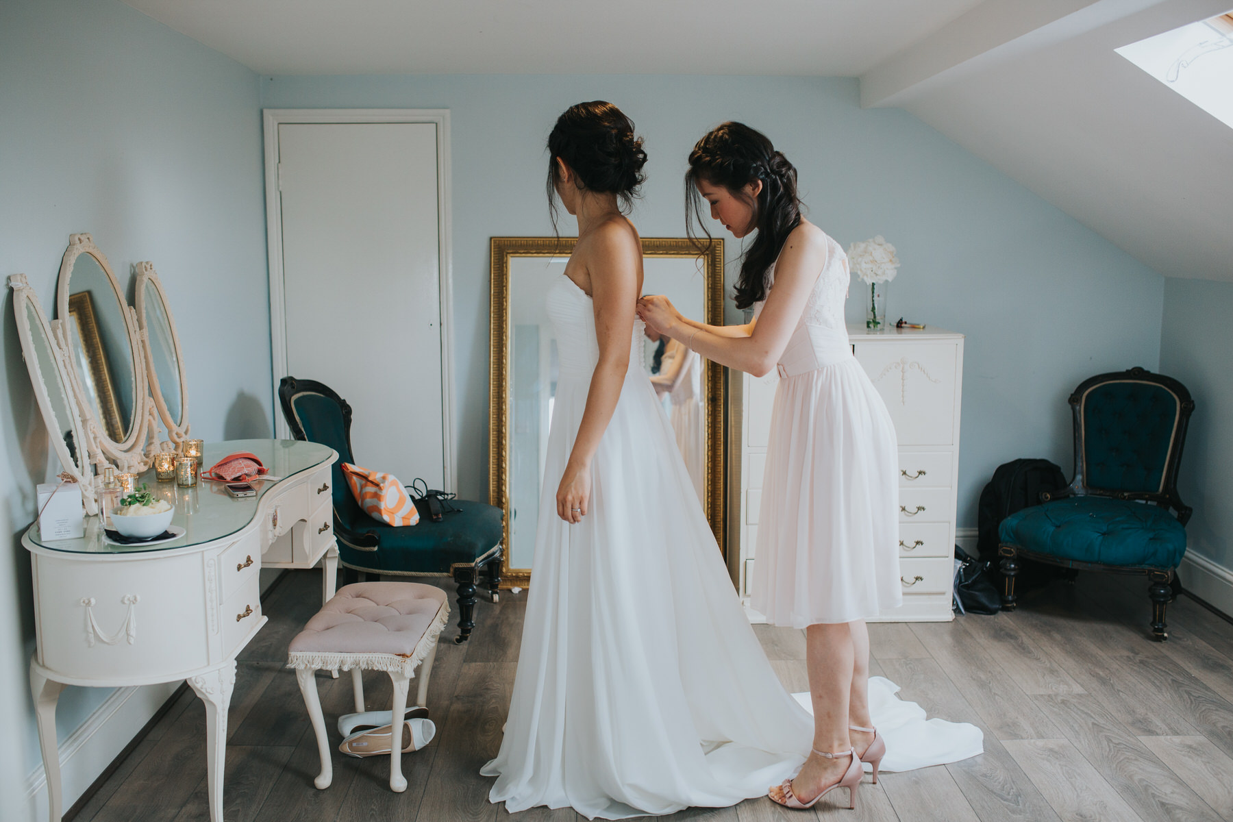 Belair House wedding bride putting on dress.jpg
