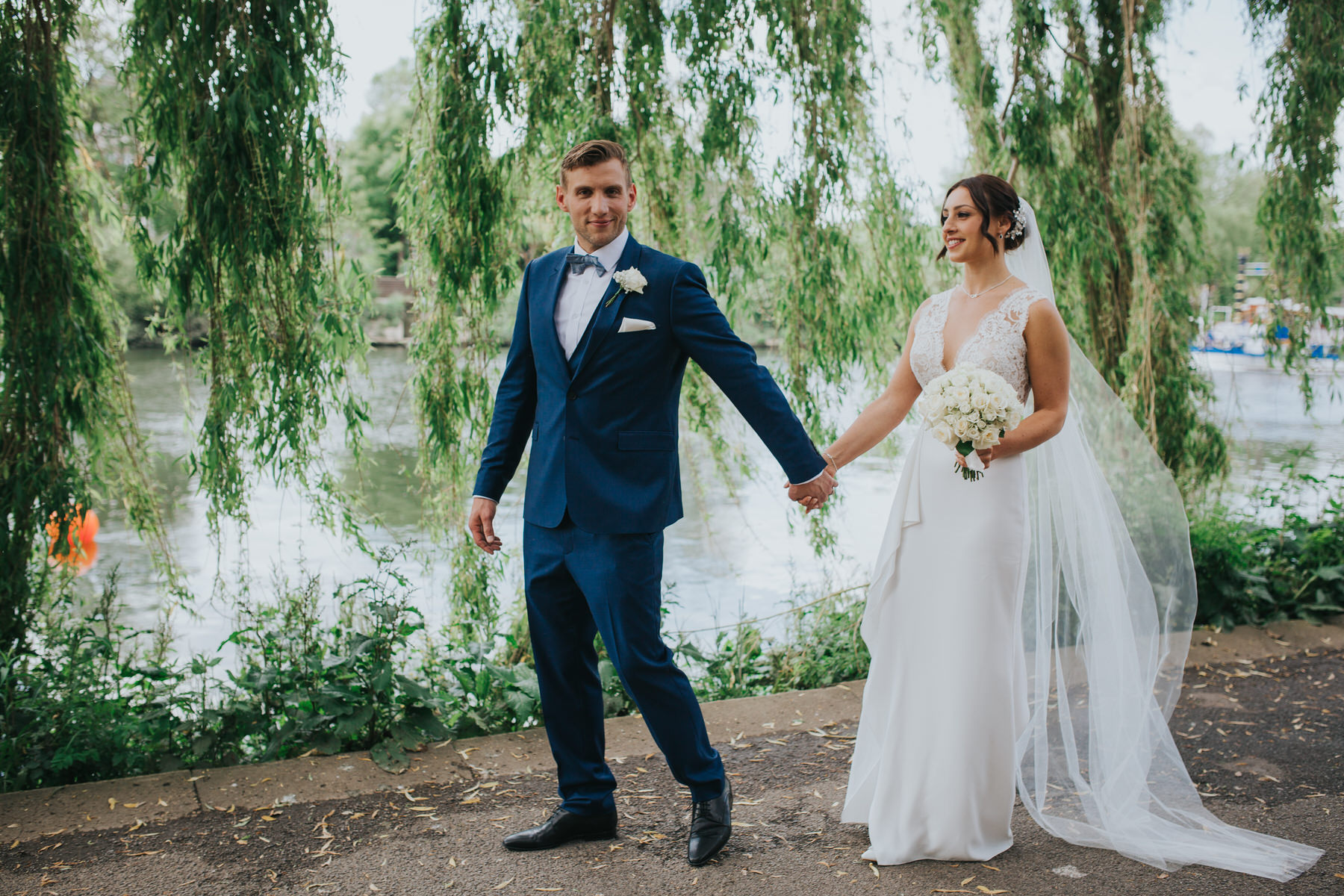 Bingham Hotel Richmond wedding photographer groom leads bride Thames towpath.jpg