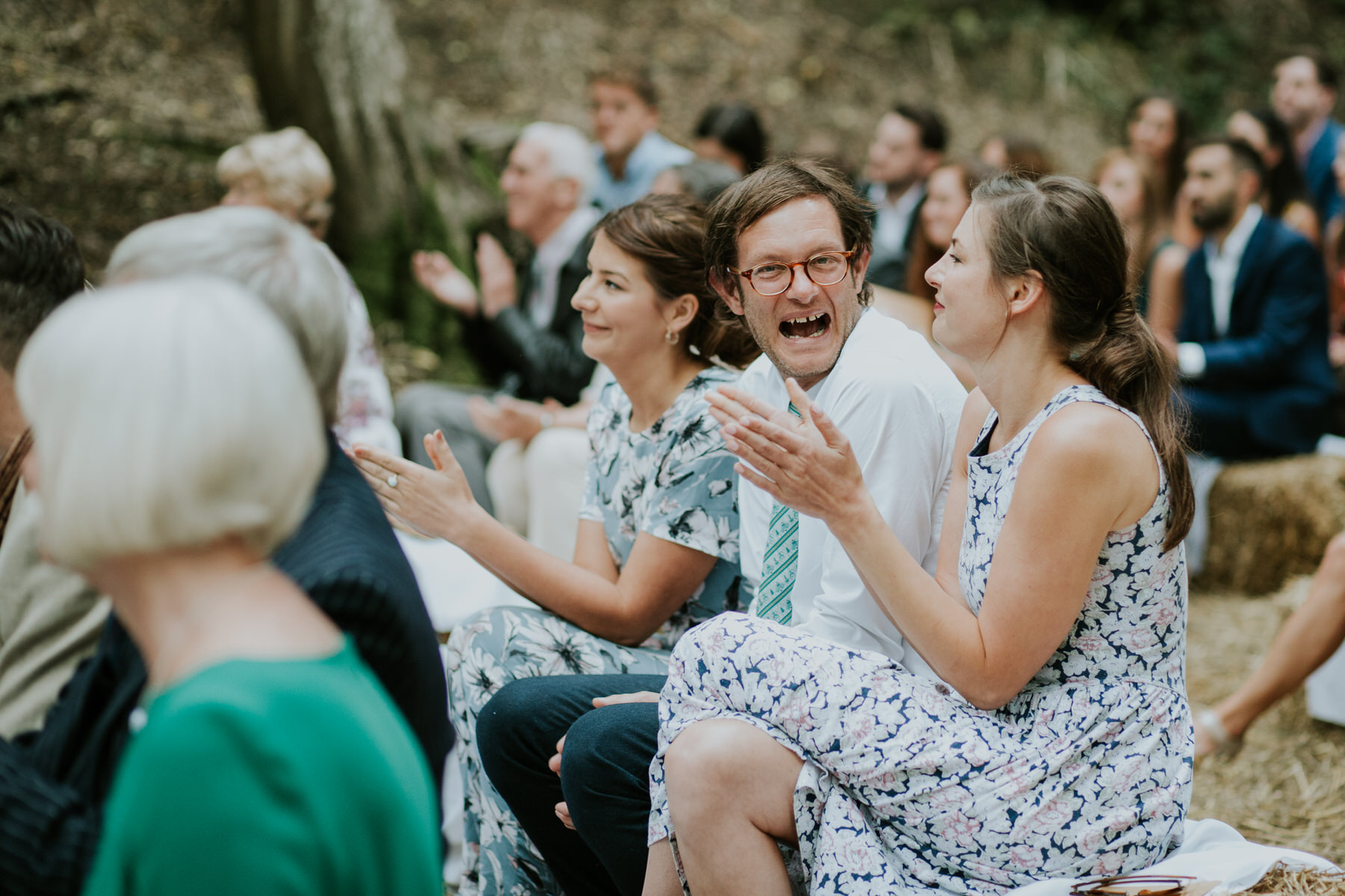 28 guests clapping celebrating Paper Mill wedding photographer.jpg