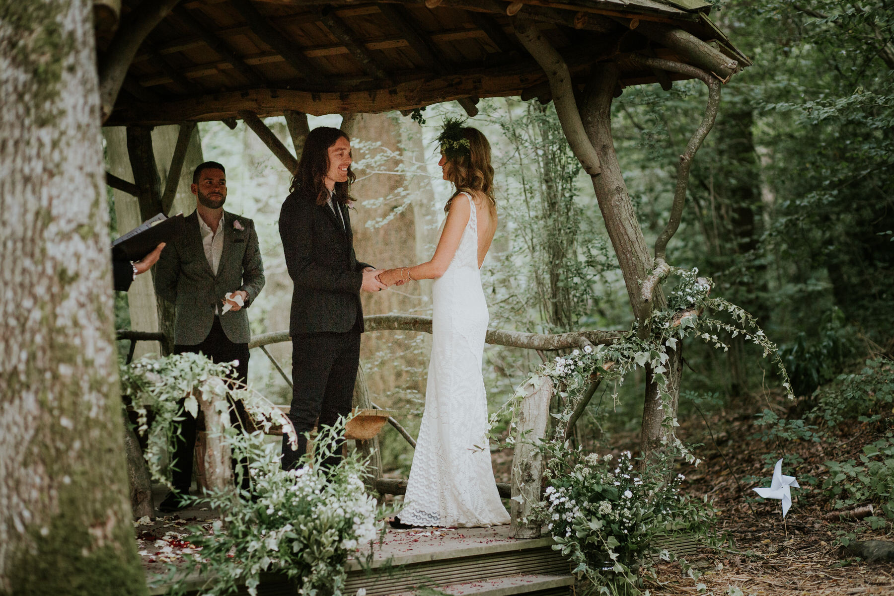 32 bride groom under wooden bower wedding ceremony Kent.jpg