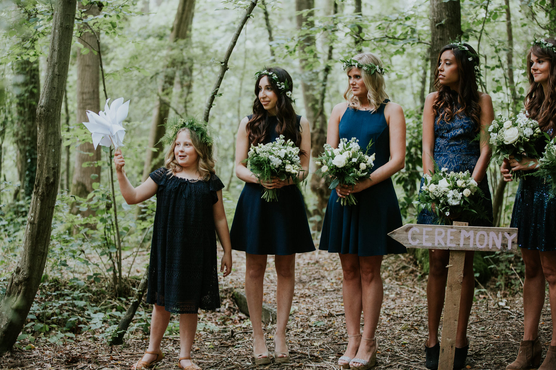 60 bridesmaids flower girl holding white origami windmill forest wedding.jpg