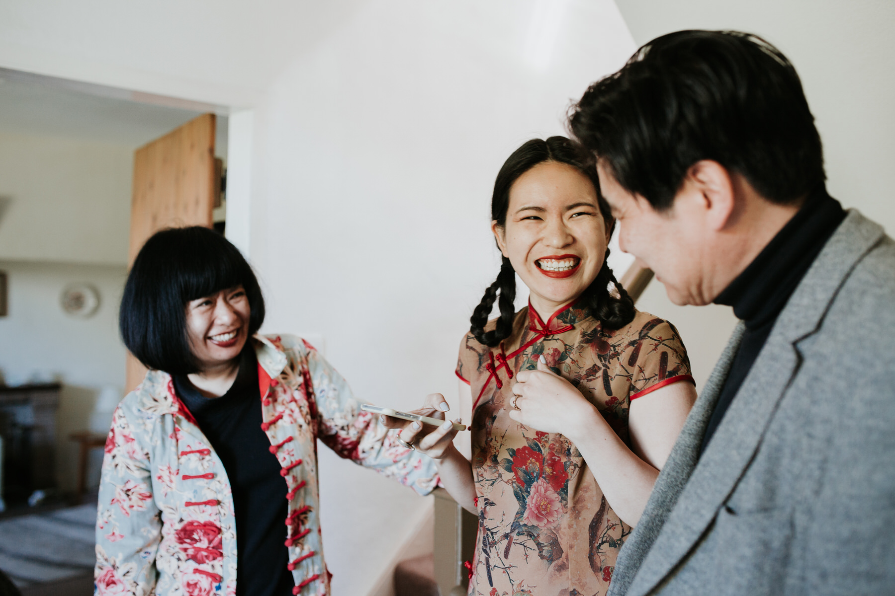 91 bride traditional Chinese dress laughing parents.jpg