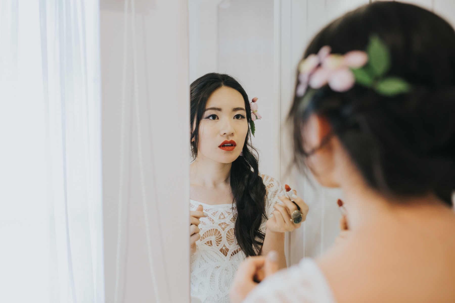 346 bride Shaina applying red lipstick wedding portrait.jpg