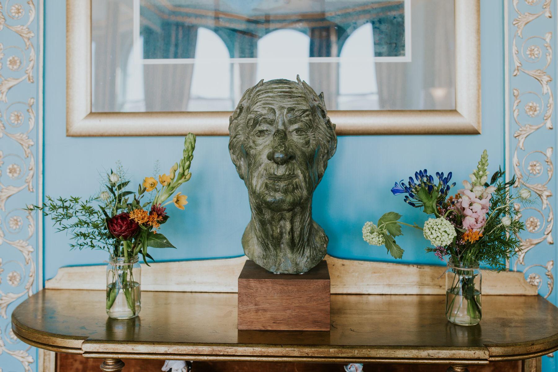 262 Portmeirion ceremony room wedding posies marble head statue.jpg