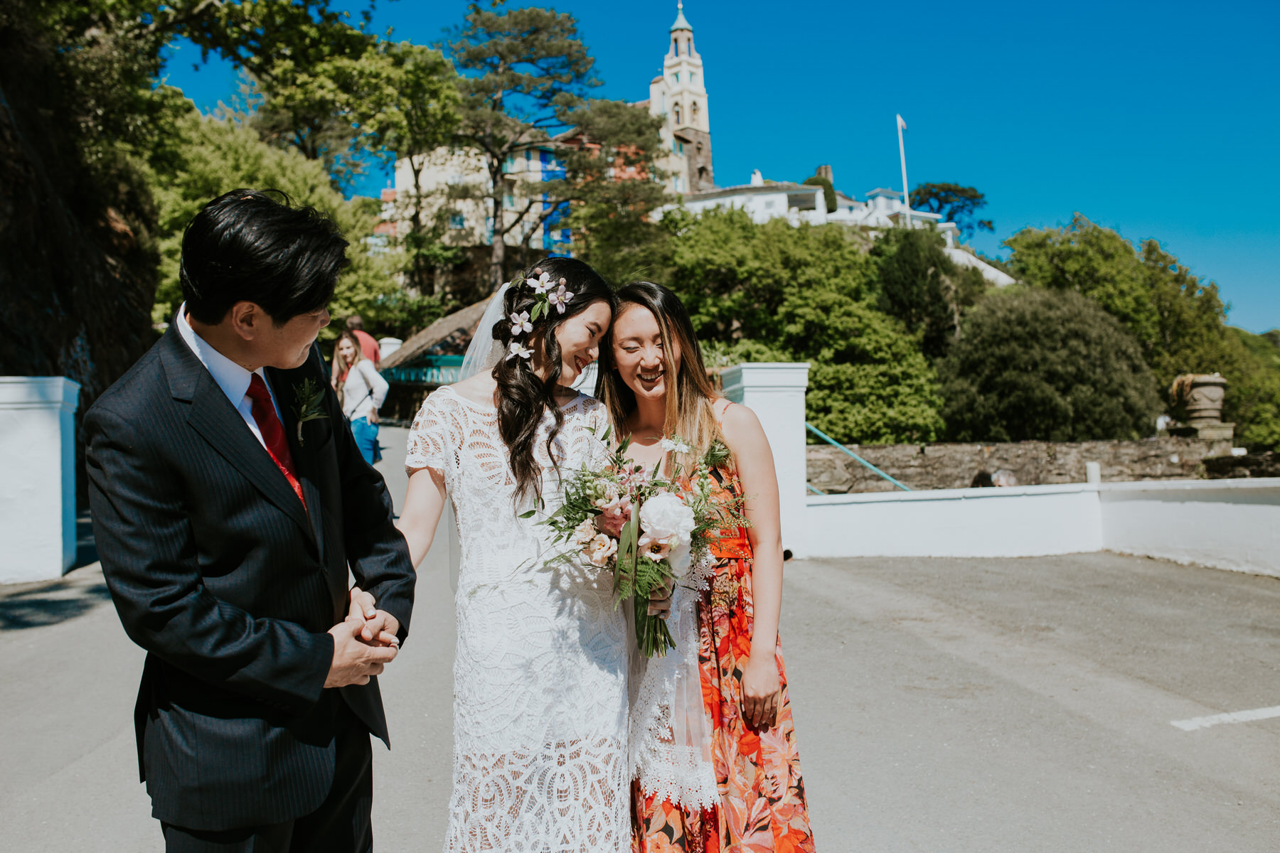 424 intimate moment between bride and bridesmaid Portmeirion Hotel.jpg