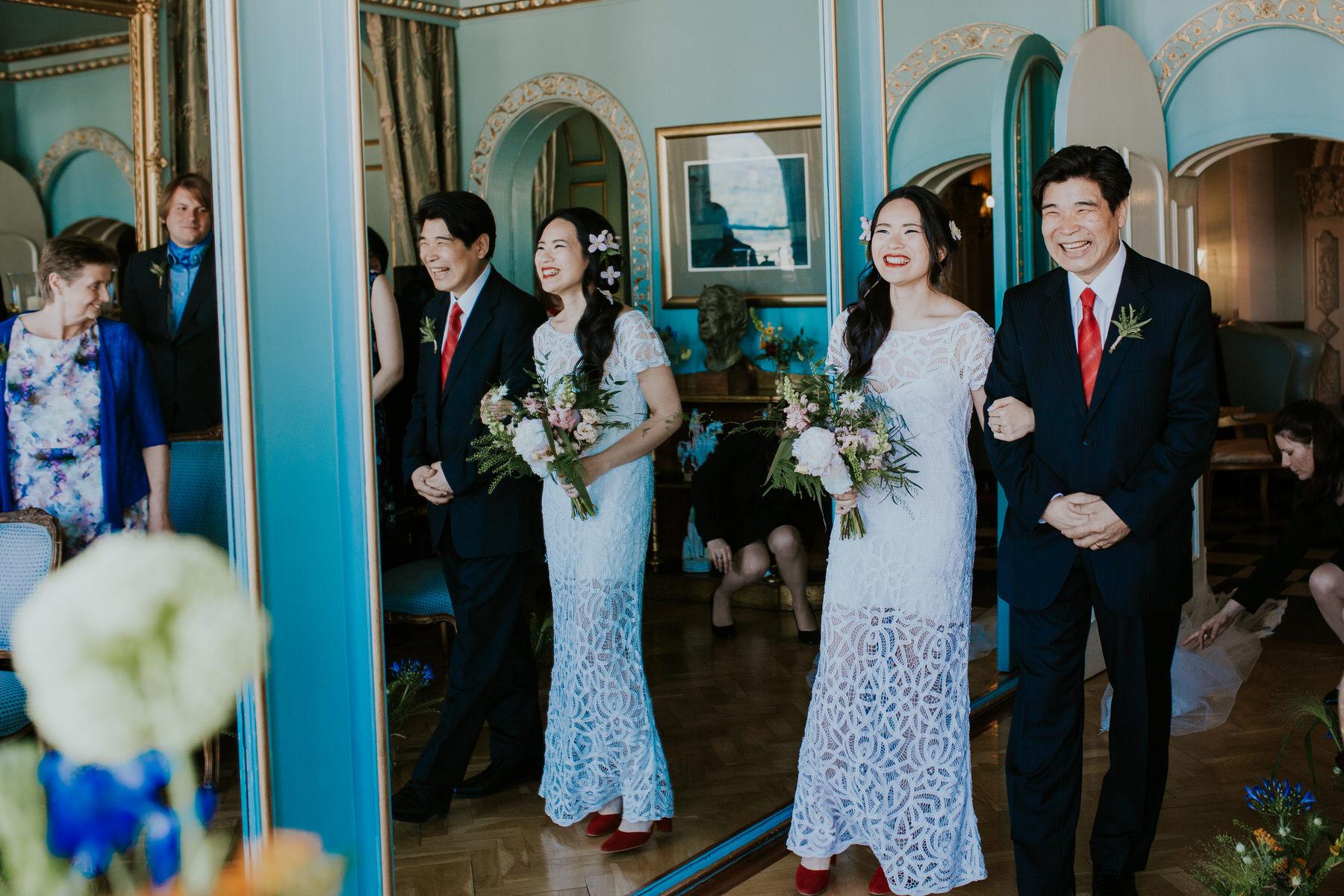 449 bride Shaina entering ceremony room father Portmeirion.jpg