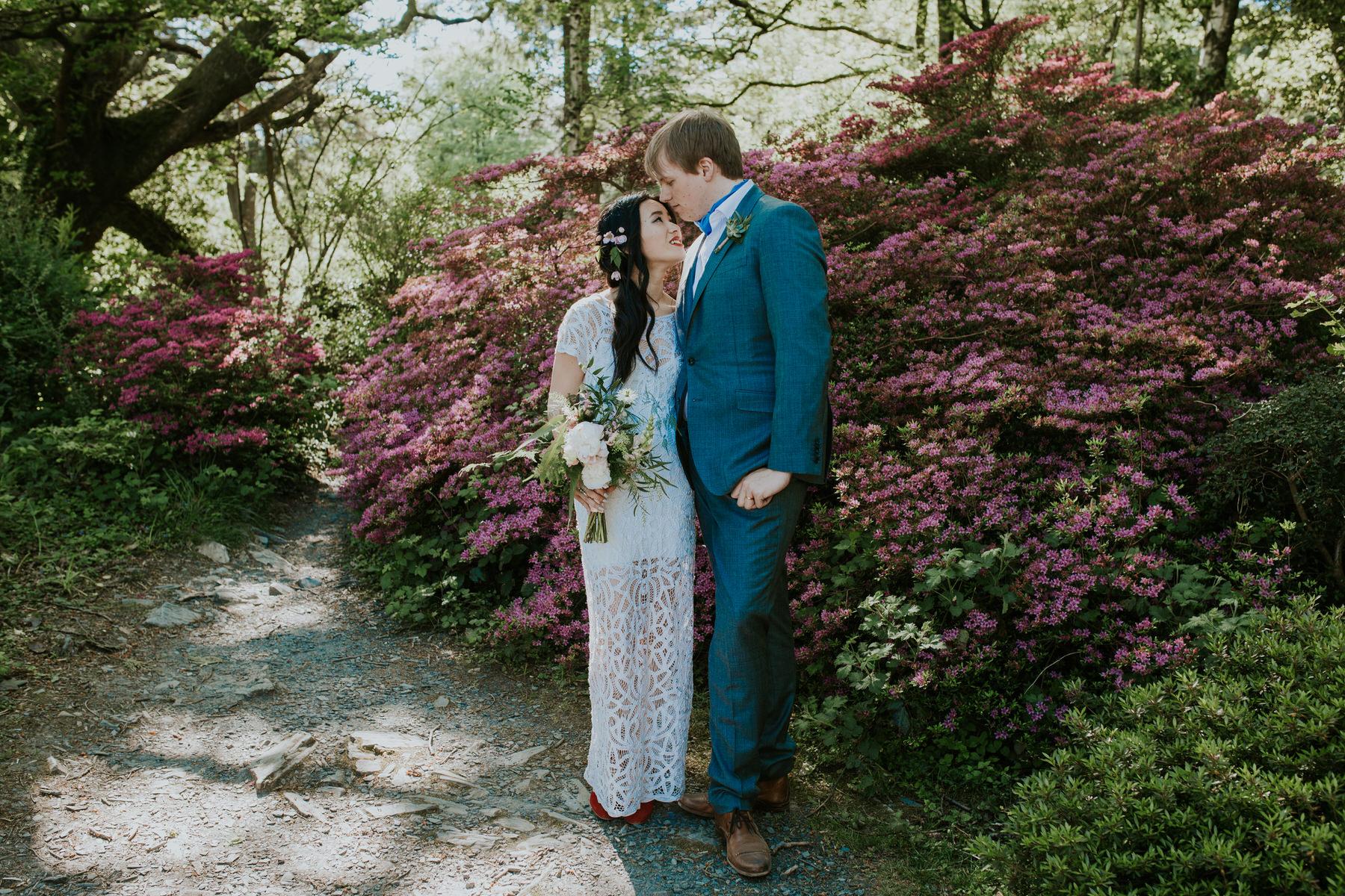 730 Portmeirion bride groom wedding portrait pink floral background.jpg
