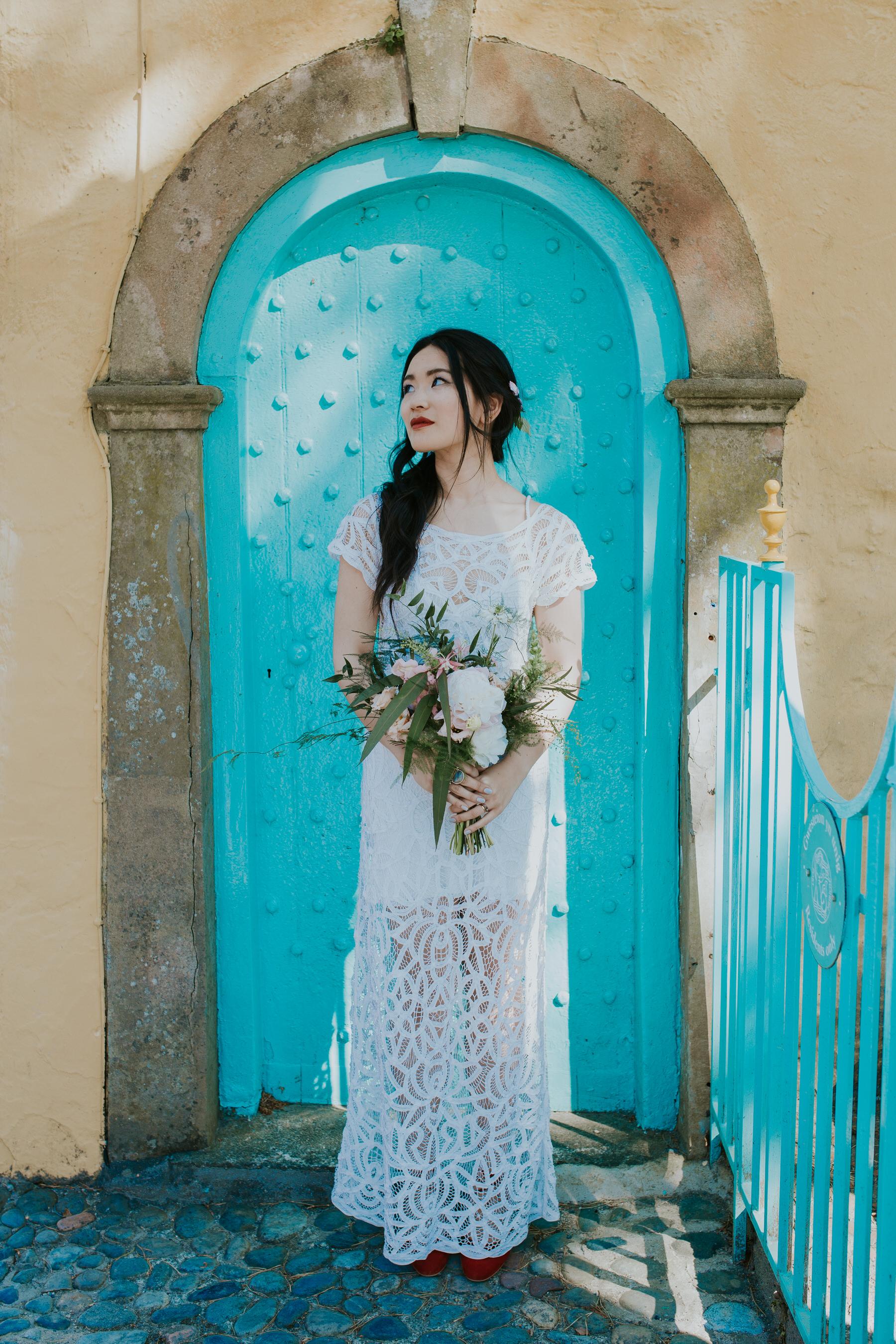 813 elegant Shaina bridal portrait turquoise door Portmeirion.jpg