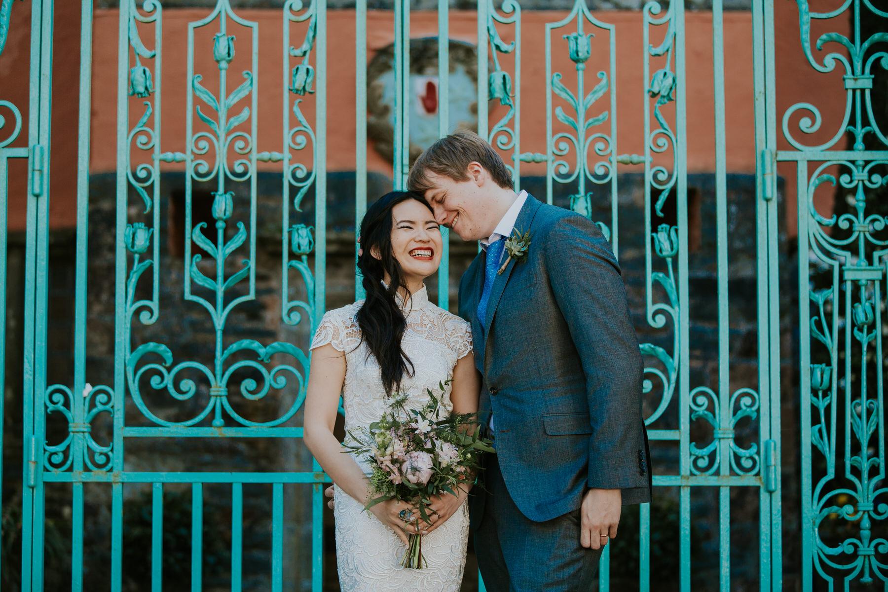 1000 Shaina & Gwilym Wedding portrait turquoise wrought iron gate Portmeirion.jpg