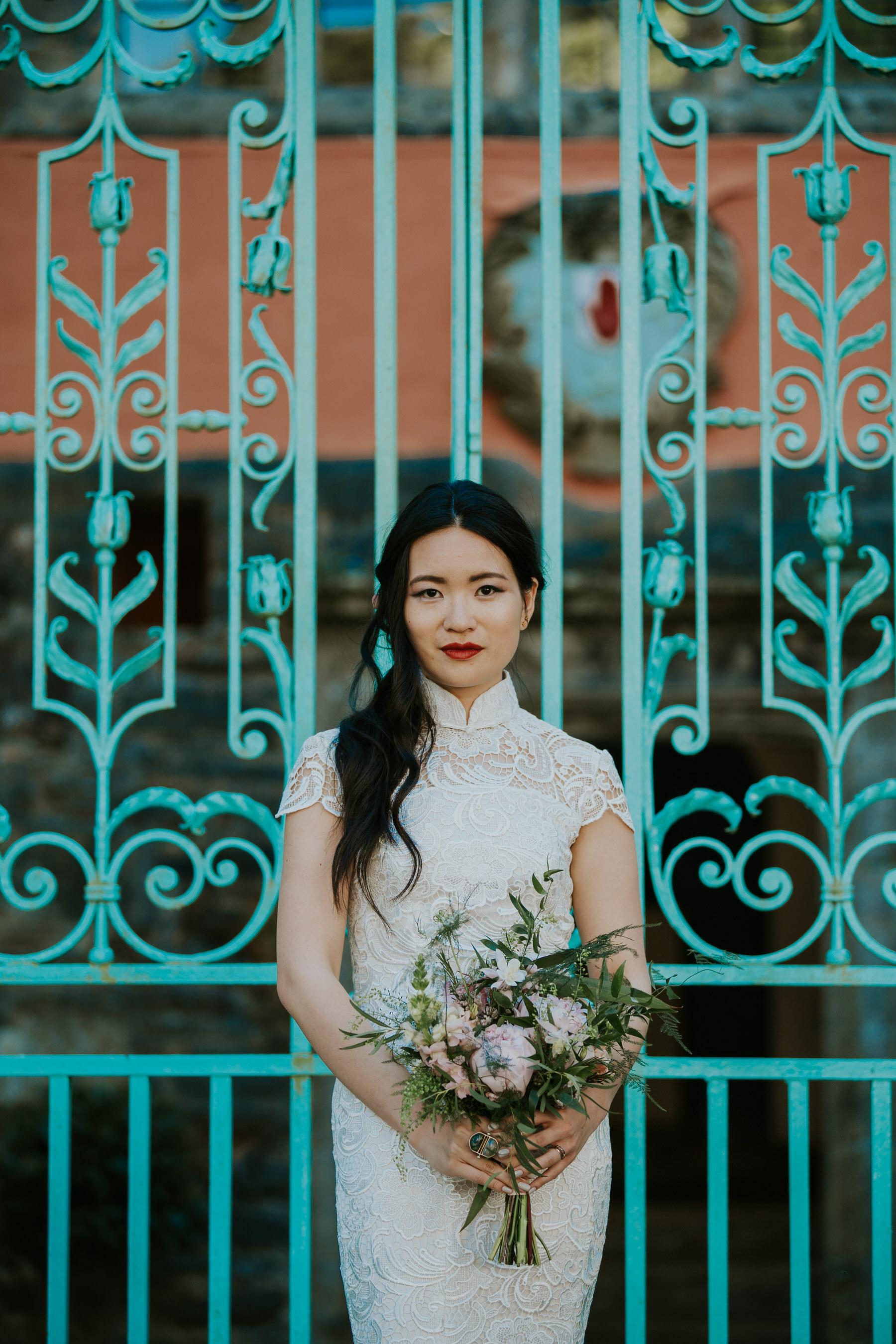 1021 beautiful elegant bridal portrait turquoise background Portmeirion.jpg