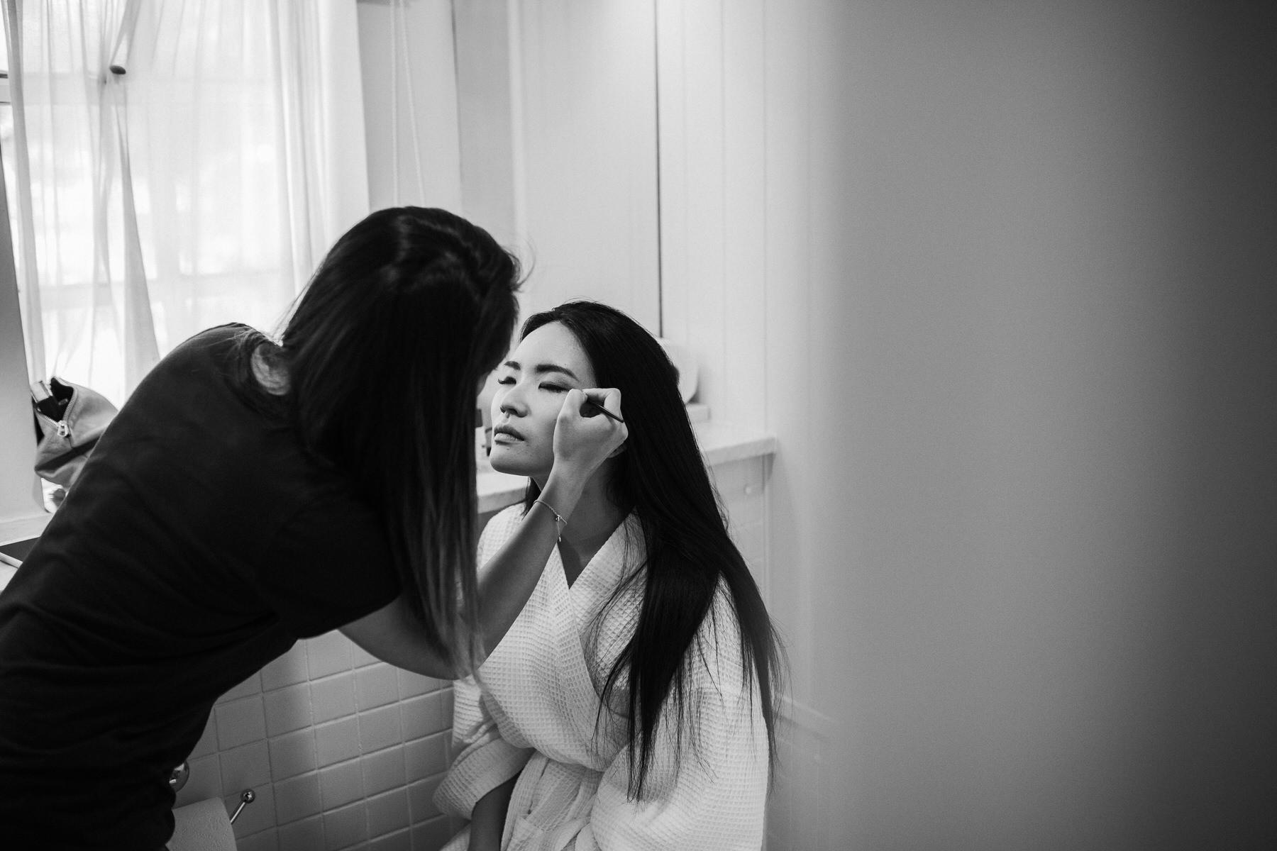 310 bride Shaina having bridal makeup applied.jpg