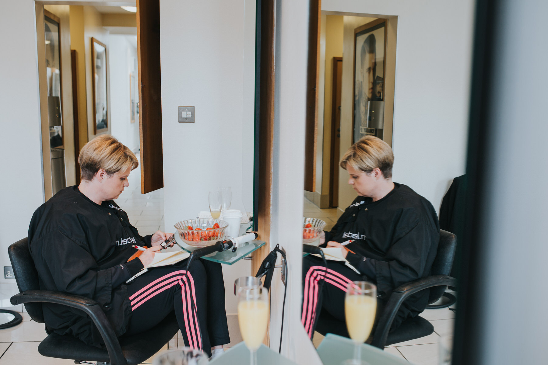 4 bride writing vows during bridal prep at hairdressers.jpg