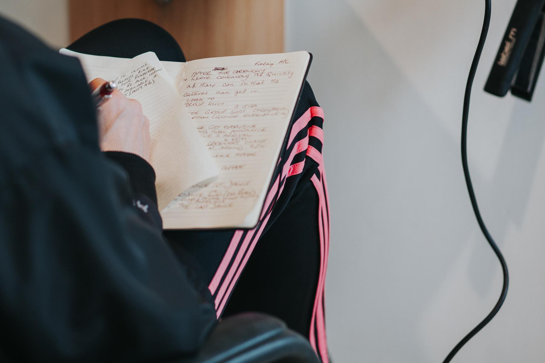5 bride writing wedding vow notes.jpg