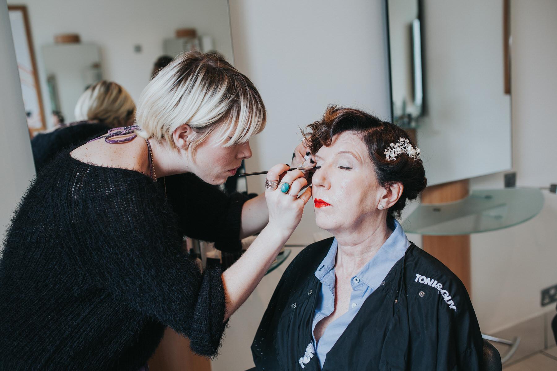 13 bride makeup applied getting ready Islington Yolande De Vries Photography.jpg