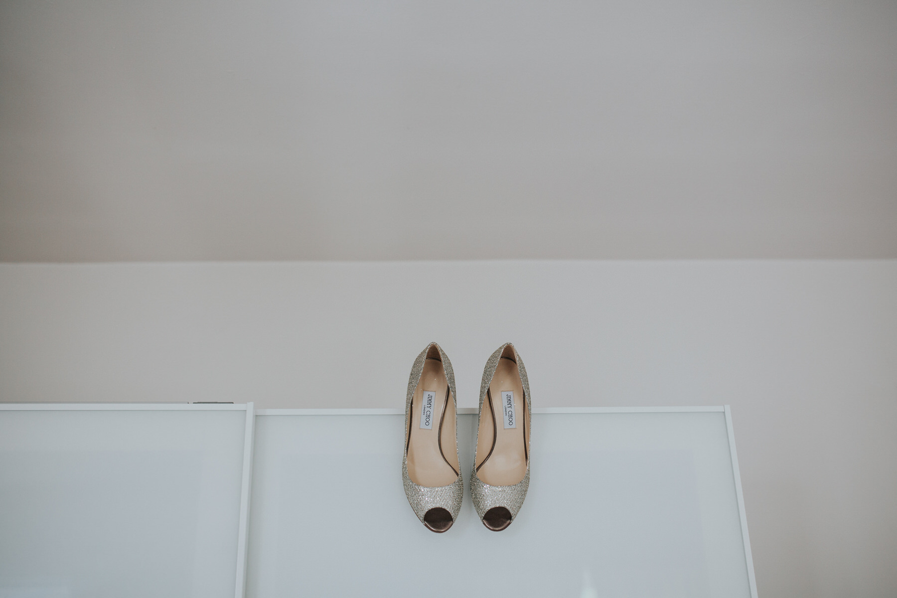 28 gold Jimmy Choo wedding heels Islington wedding photographer.jpg