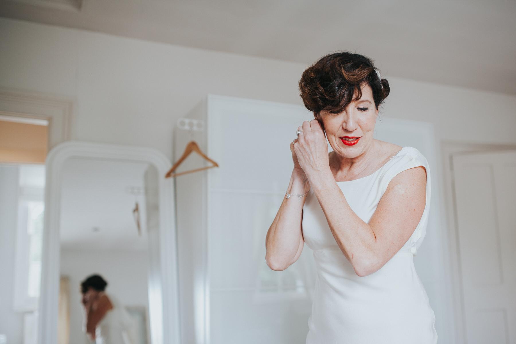 31 bride clipping earing Ghost wedding dress London.jpg