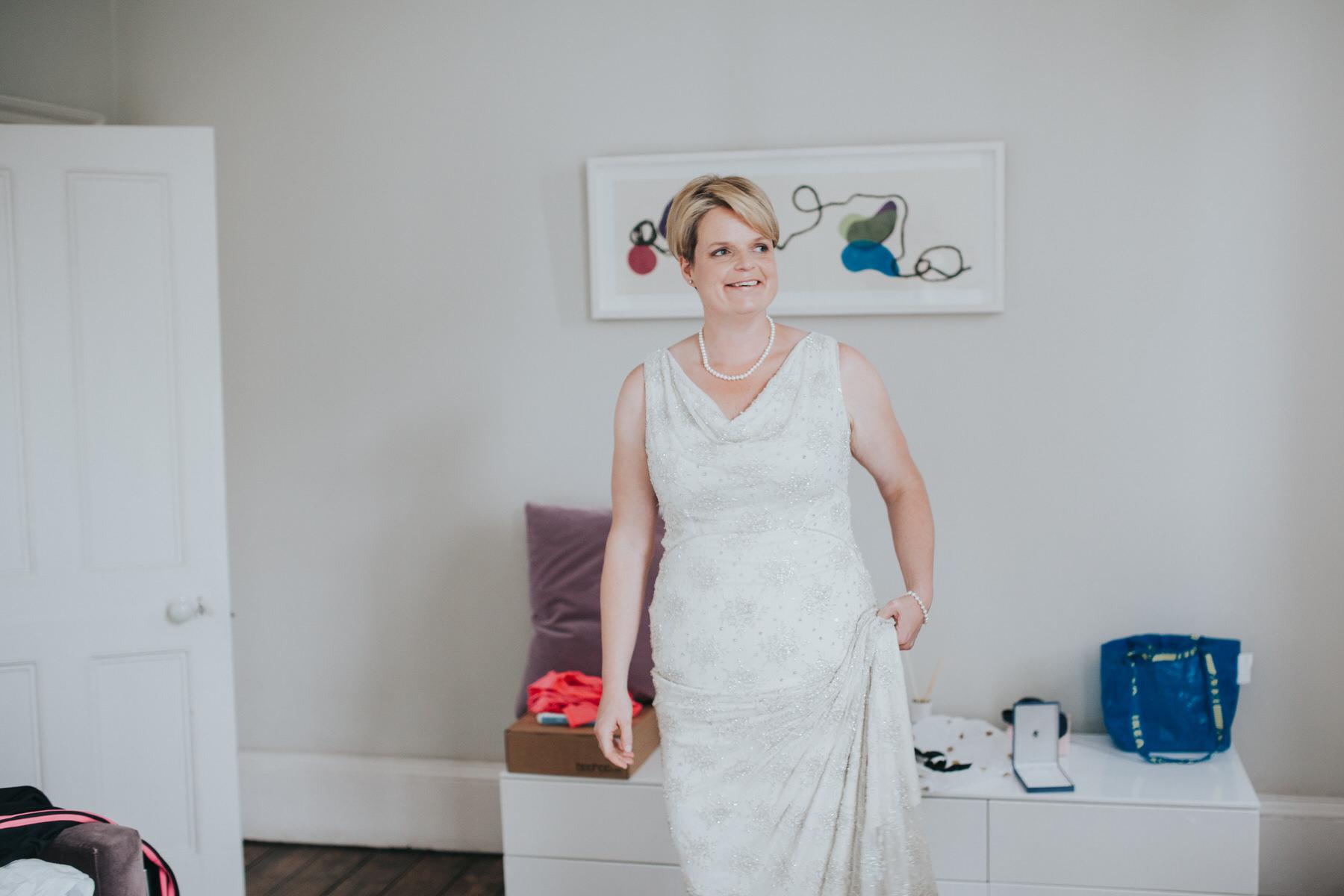 38 happy smiling bride Islington wedding photographer.jpg
