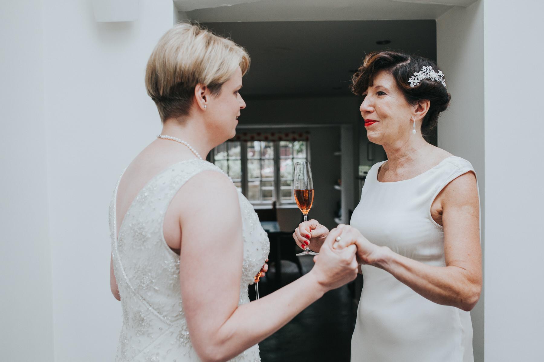 50 intimate moment between two brides Islington wedding photographer.jpg
