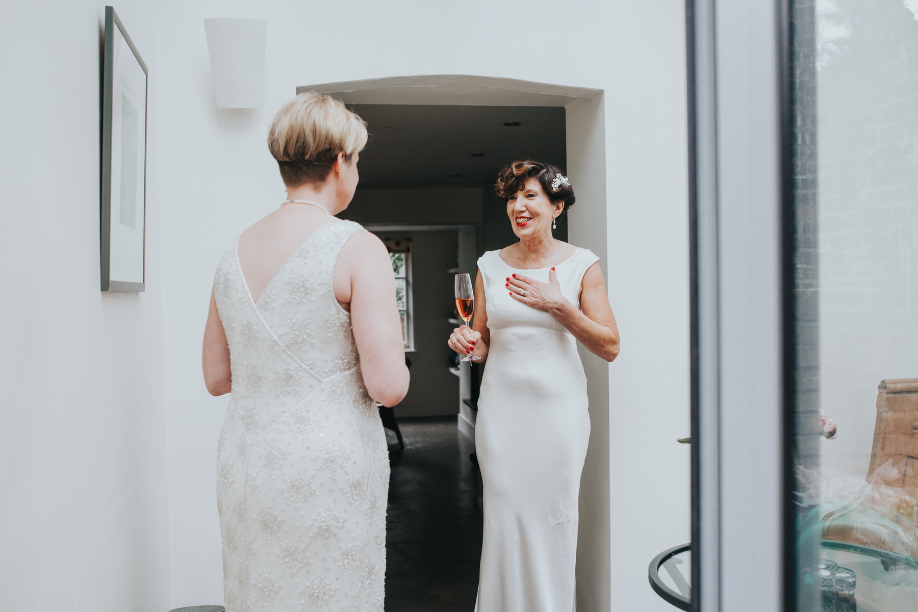 48 emotional first look two brides Islington photo.jpg