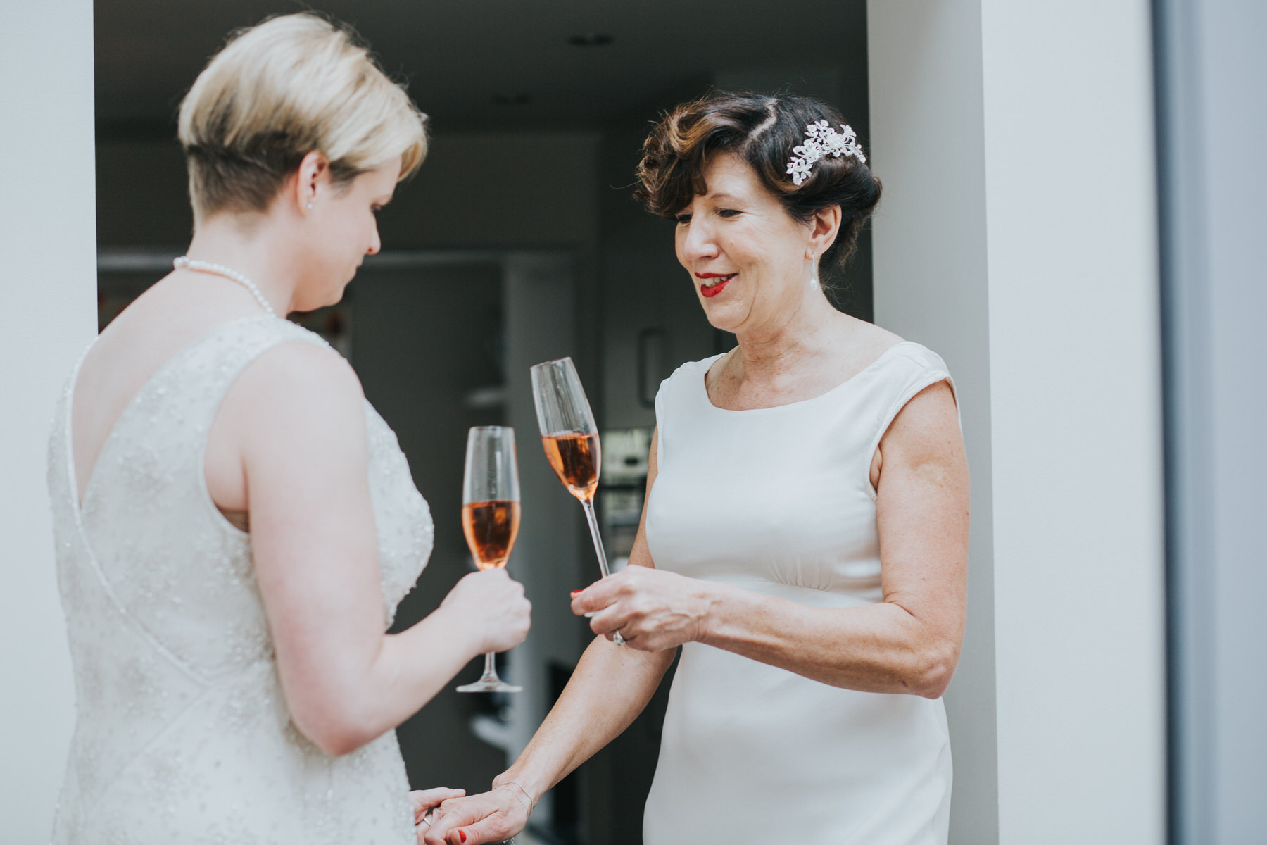 58 two brides toast pink champagne Islington.jpg