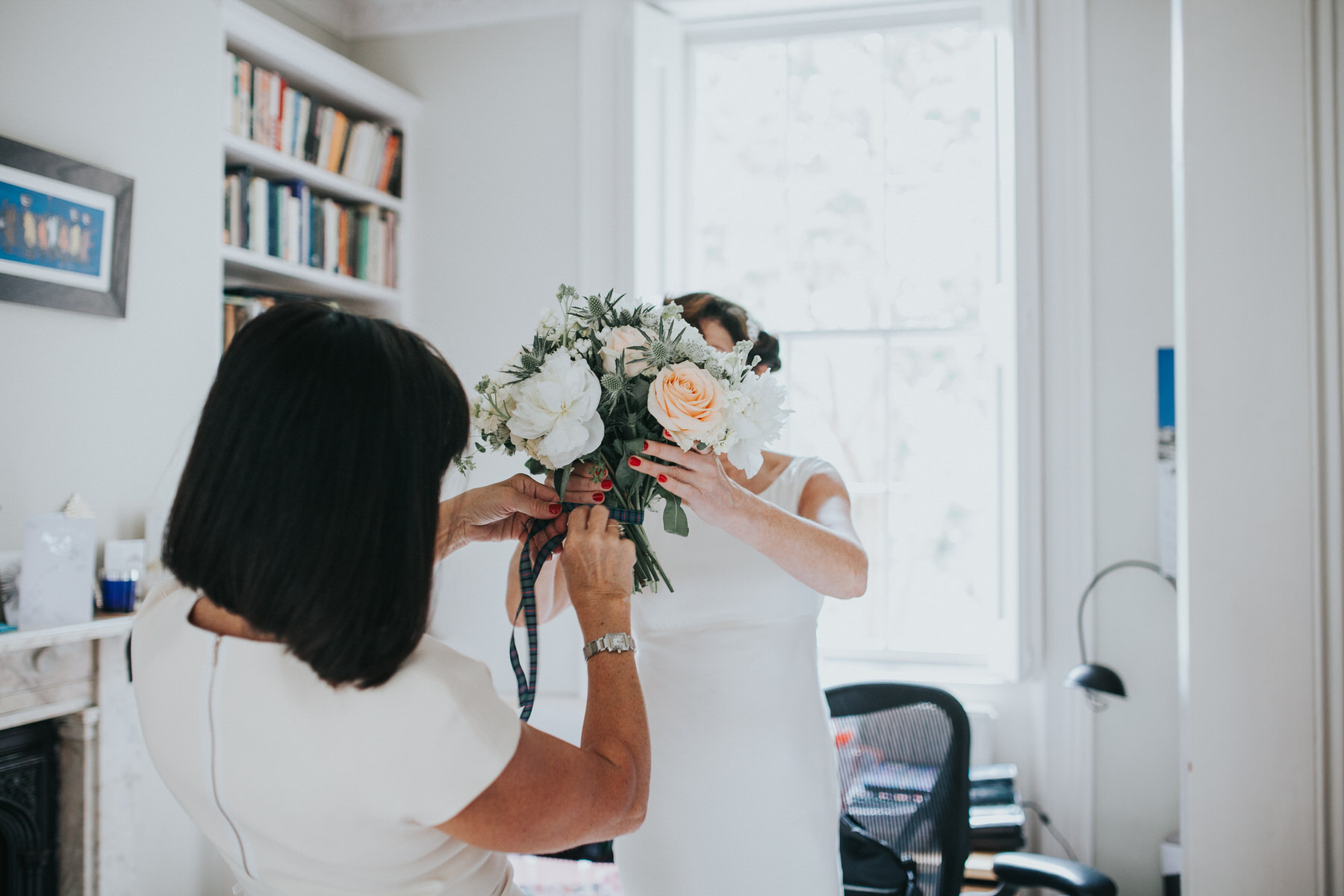 62 Islington wedding bridal prep tying bouquet.jpg