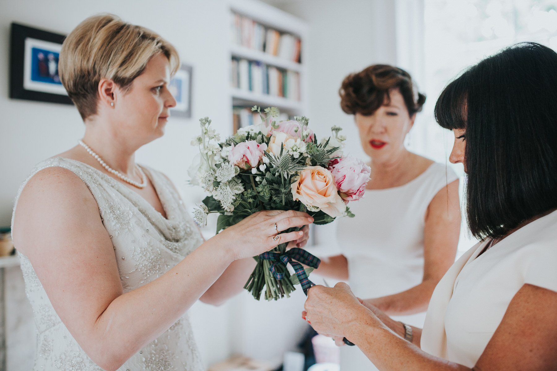 63 Islington wedding bridal prep tying bouquet.jpg