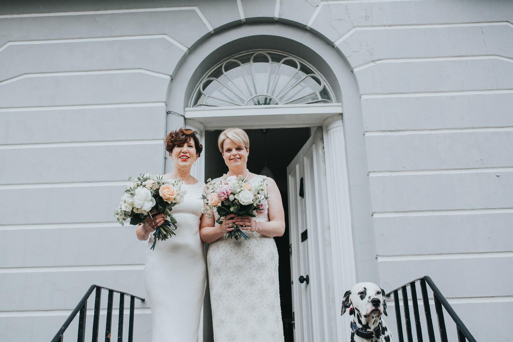 67 two brides wedding portraits grey wall dalmatian dog.jpg