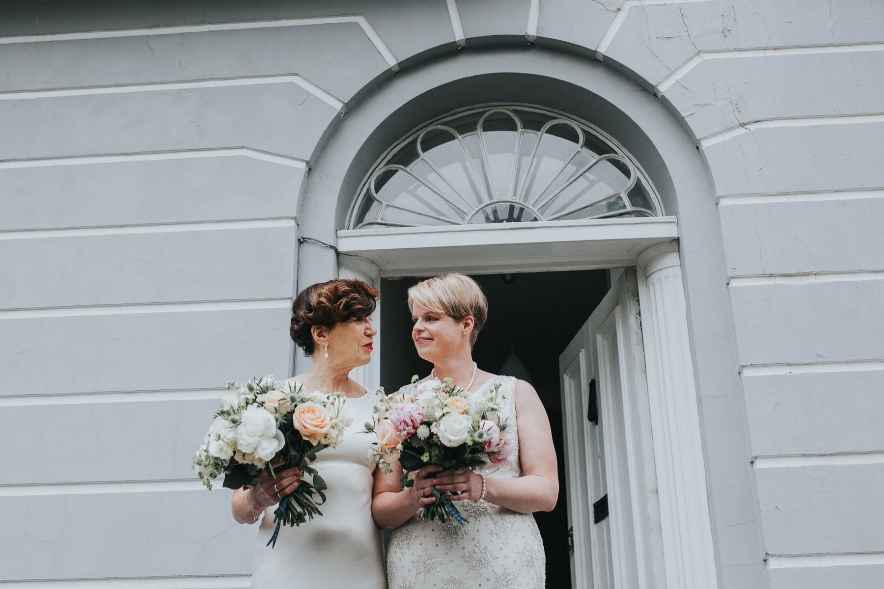 69 Islington two brides wedding portraits grey wall.jpg
