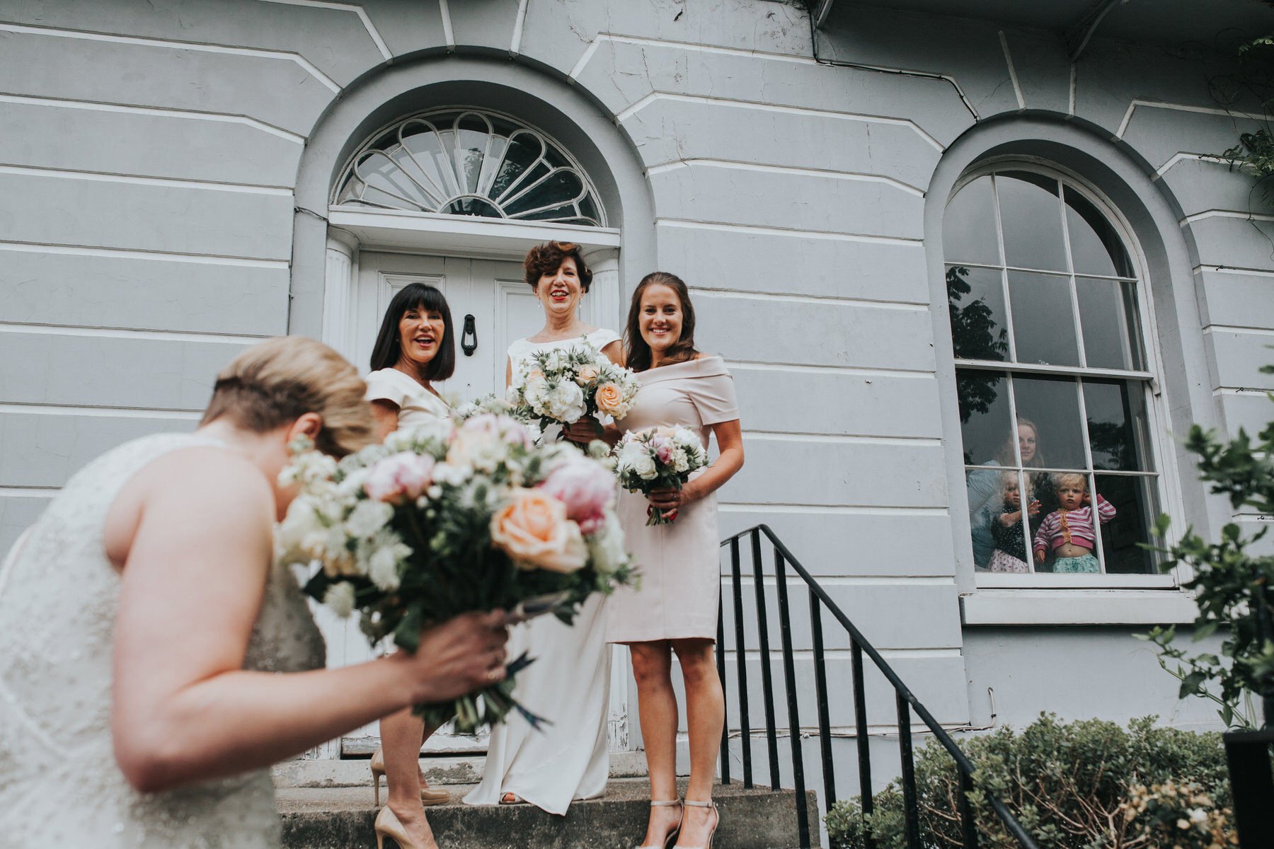 72 Islington reportage wedding photographer neighbours peeking window.jpg