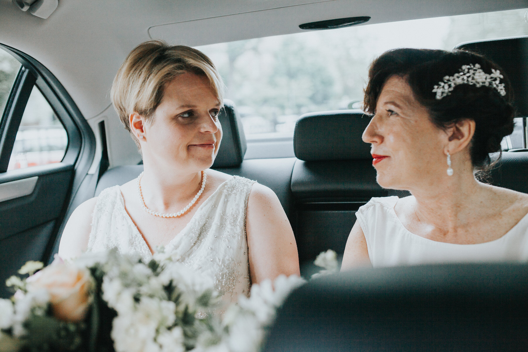 75 Islington London two brides head to ceremony in car.jpg