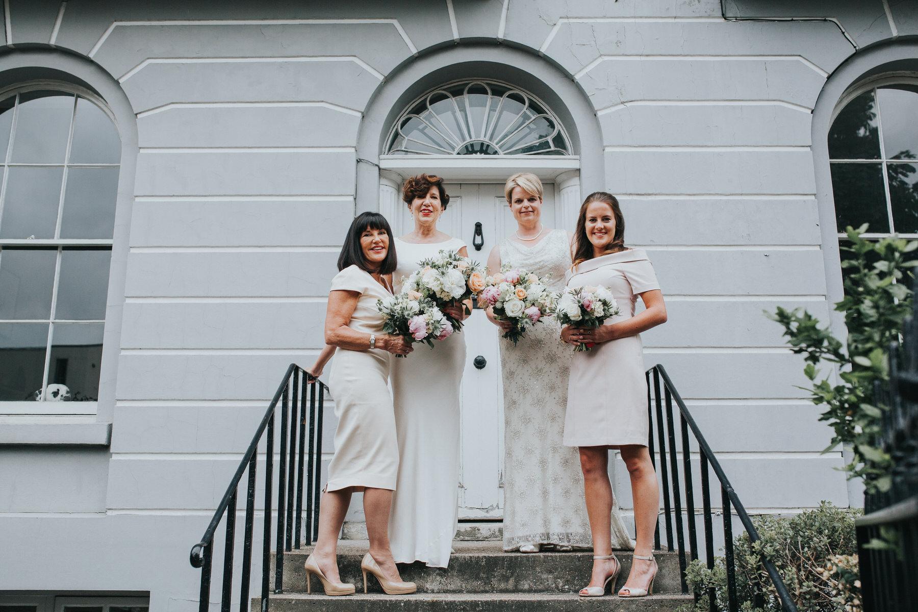 74 family photo Islington brides wedding portraits grey wall.jpg
