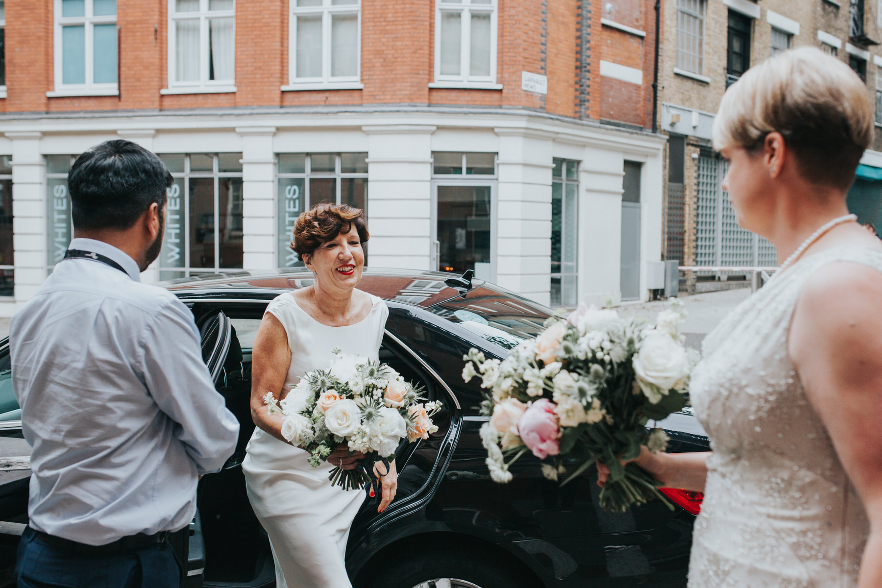 77  two brides arriving Finsbury Town Hall wedding.jpg