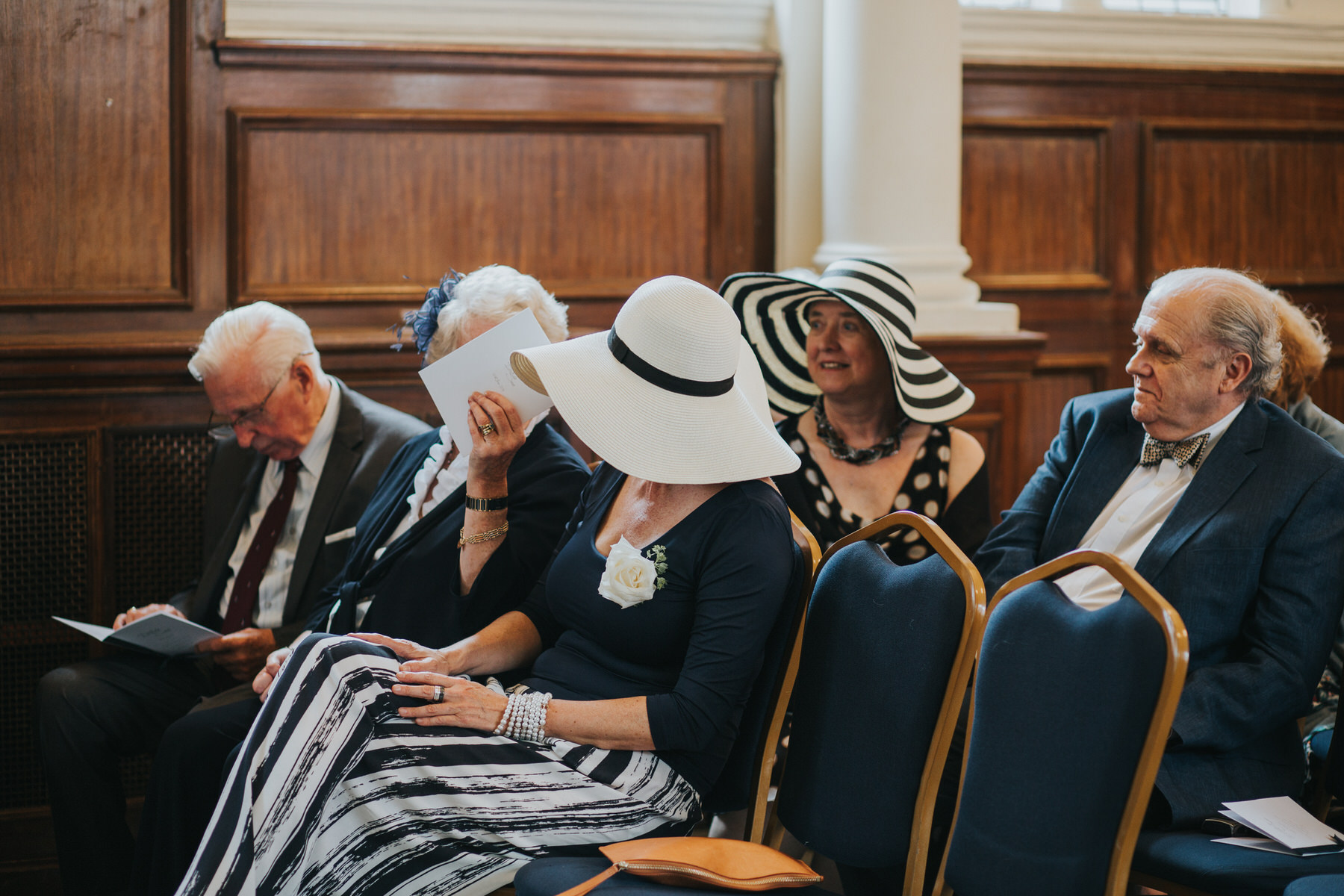 83-Finsbury Town Hall wedding ceremony guest hats stripes.jpg