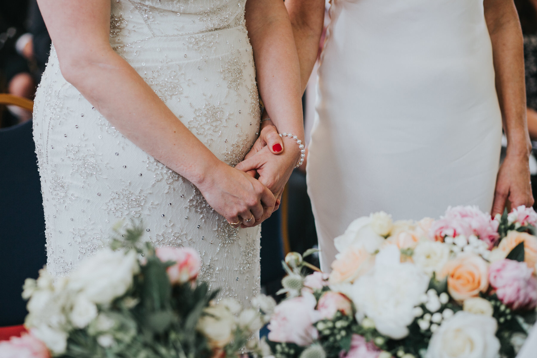 101 two brides holding hands Old Finsbury Town Hall wedding ceremony.jpg