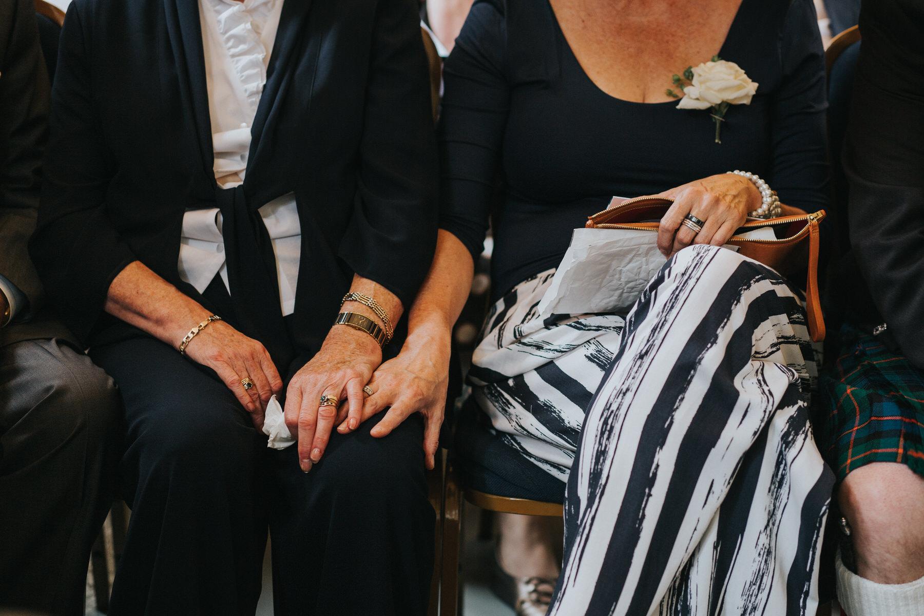 102 sister holding mums hand emotional wedding ceremony two brides.jpg