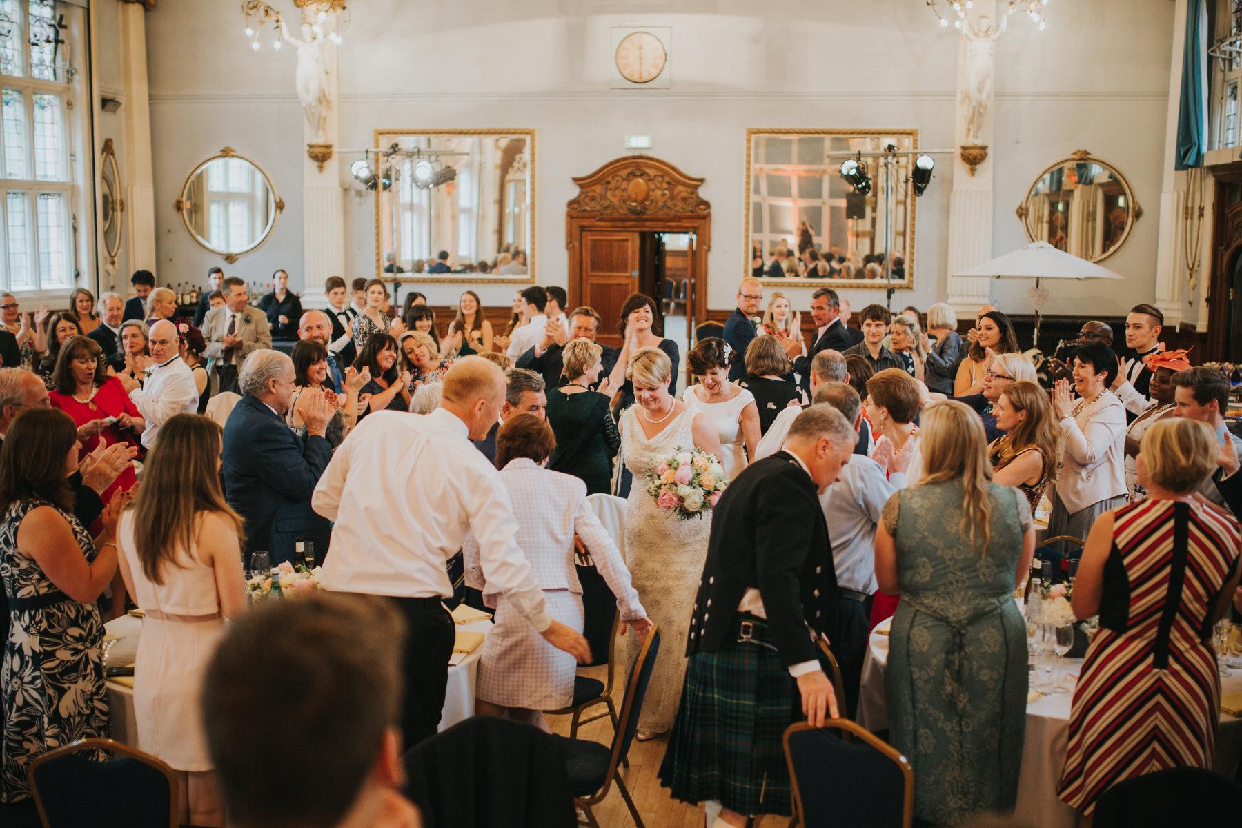 217 two brides enter Grand Hall wedding reception.jpg
