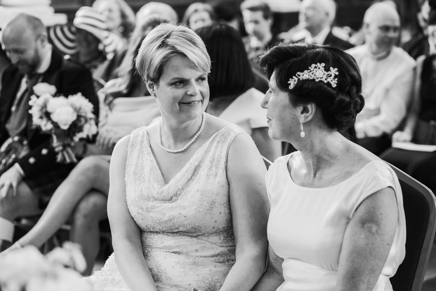 118 BW intimate moment Finsbury Town Hall wedding two brides.jpg