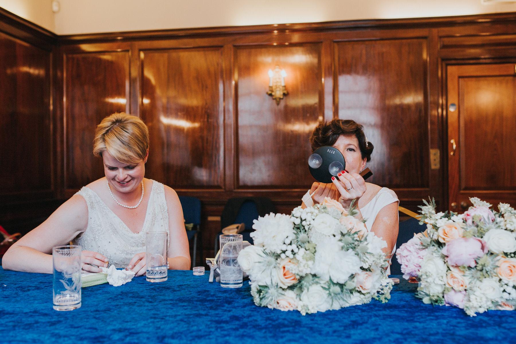 125 two brides top up makeup wedding photographer.jpg