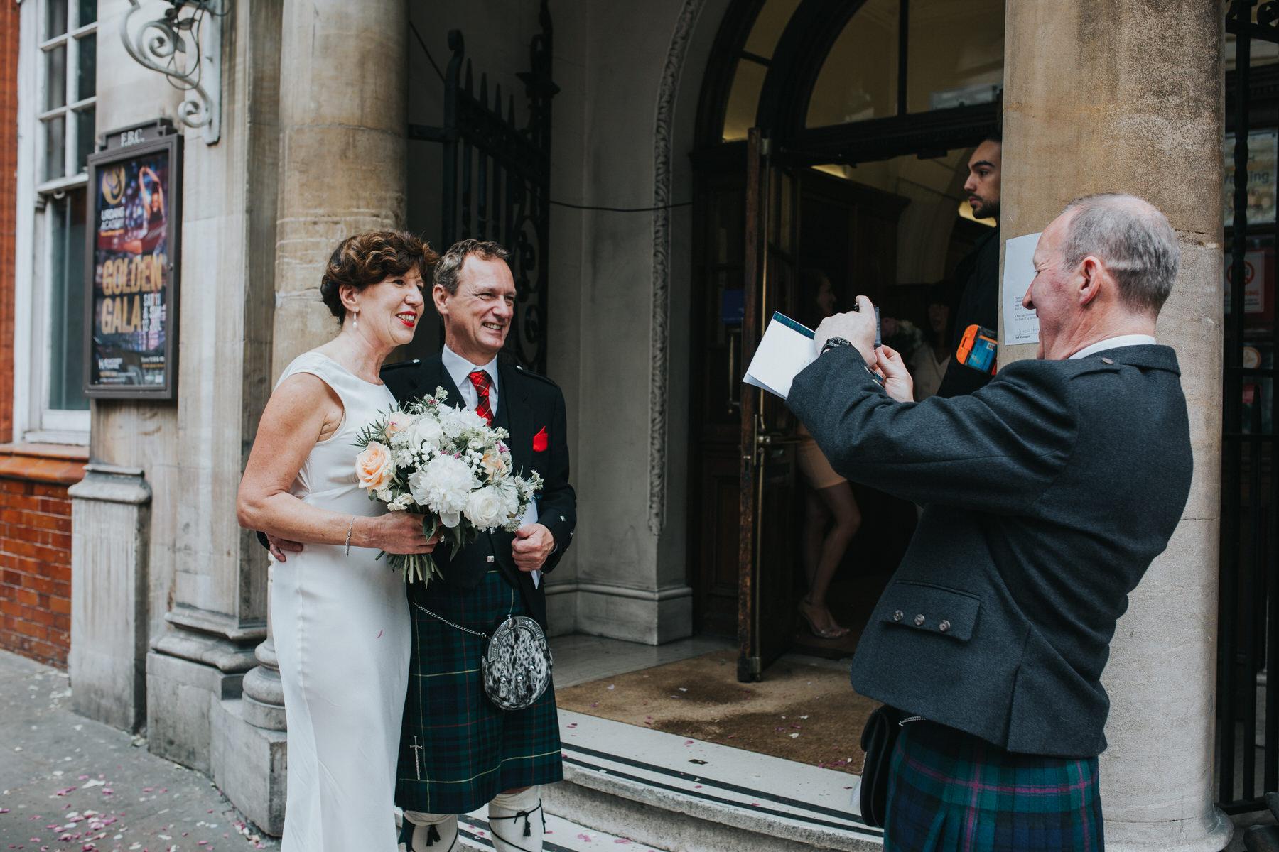 131 bride having photo taken reportage wedding photos.jpg
