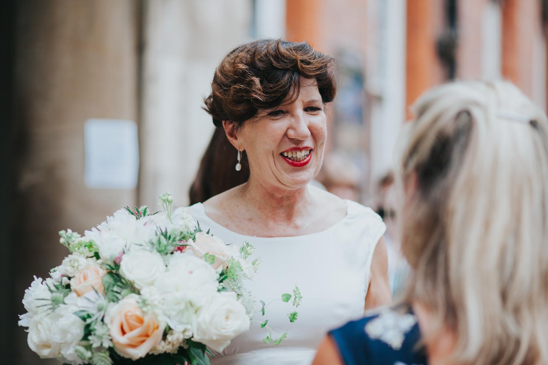135 reportage wedding photographer bride smiling.jpg