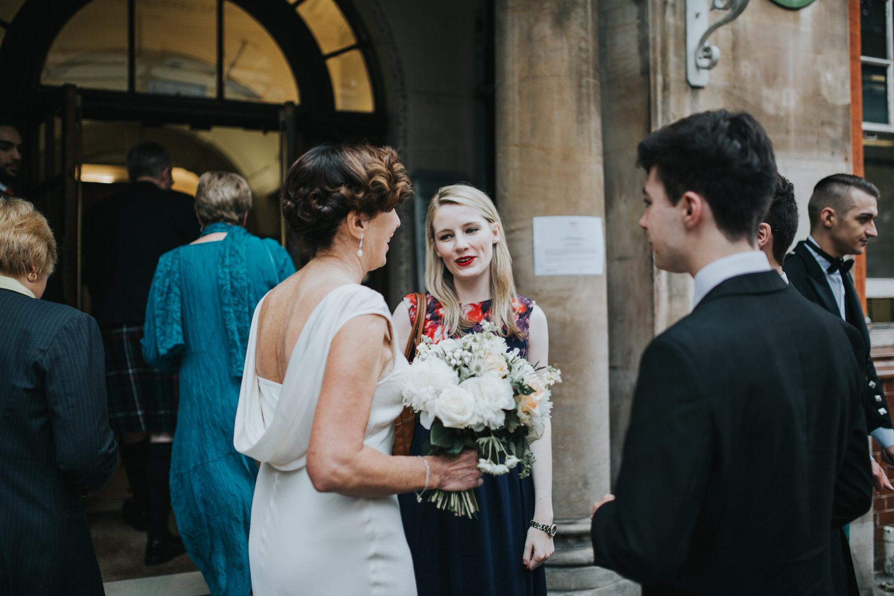 138 bride chatting guests documentary wedding photos.jpg