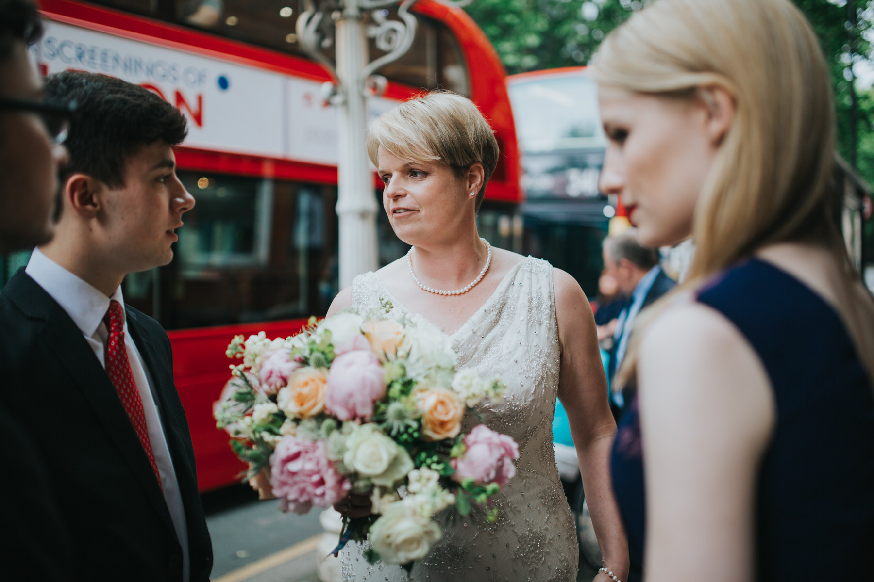 139 bride outside Finsbury Town Hall reportage wedding.jpg