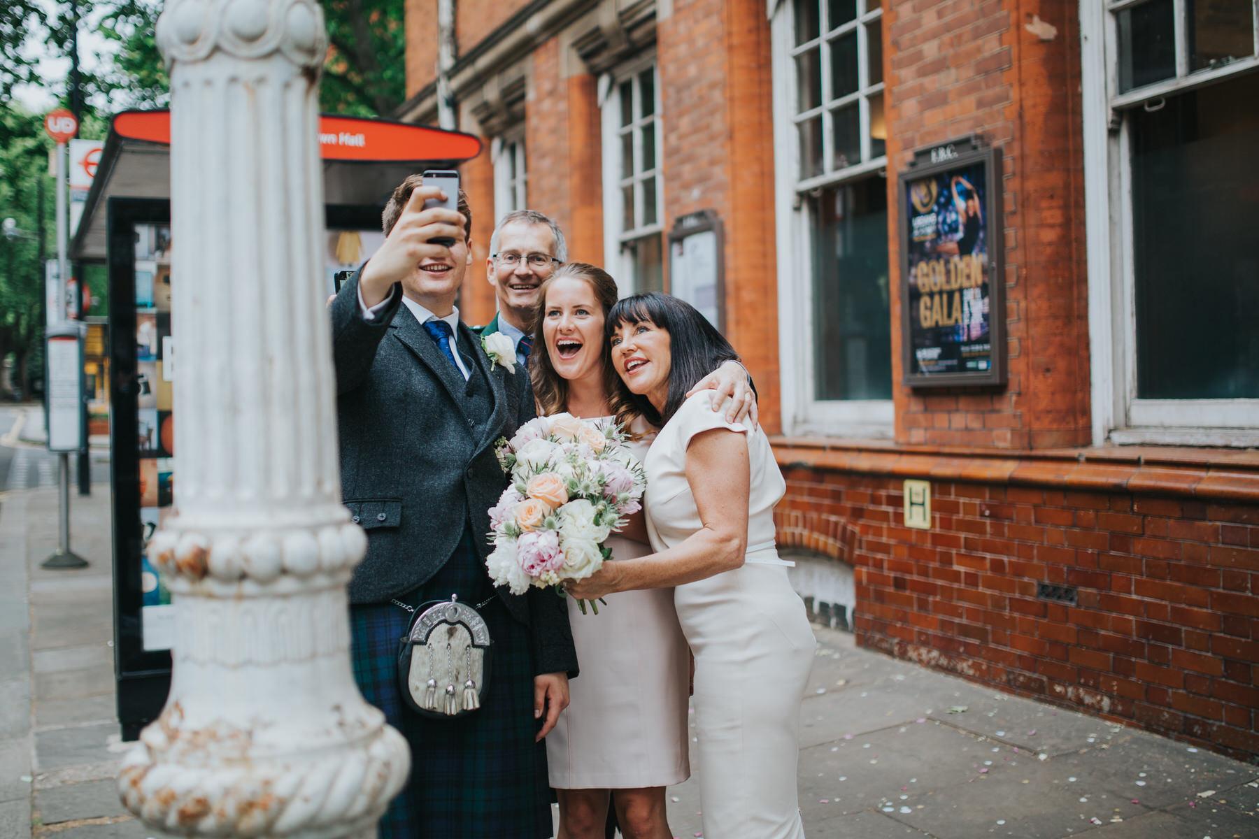 143 family taking selfie reportage wedding photographer.jpg