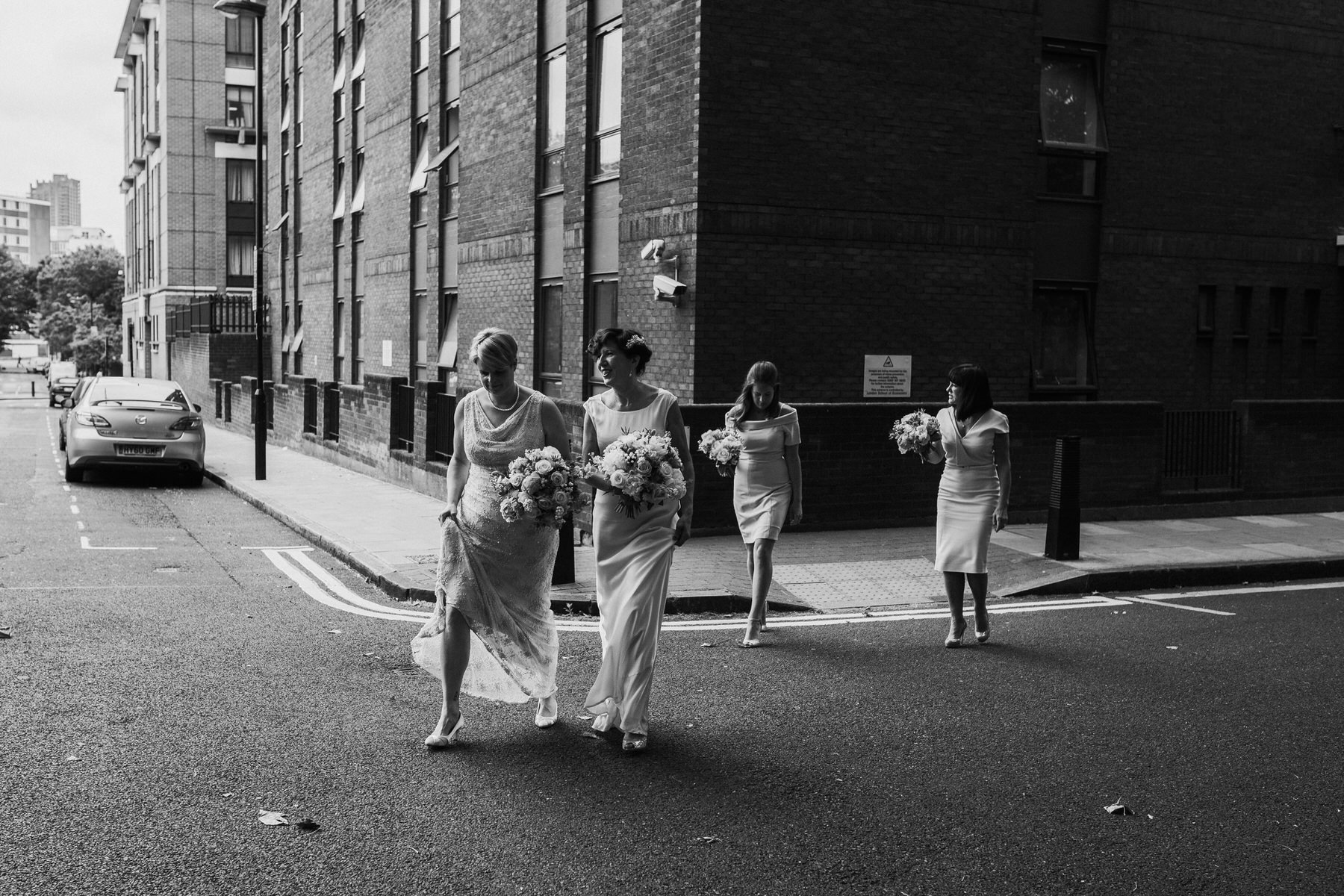 147 BW brides walking with bridal party.jpg