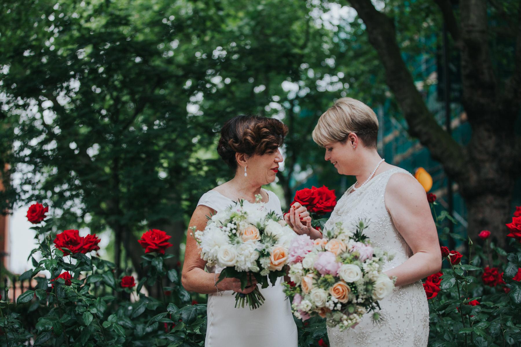 149 two brides couple portraits Islington park red roses.jpg