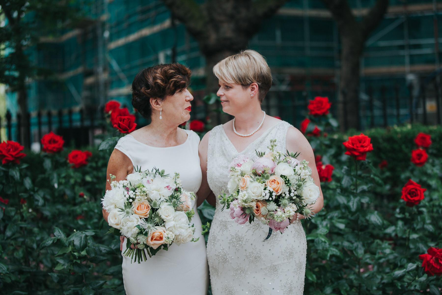 151 red roses Islington park two brides couple portraits.jpg