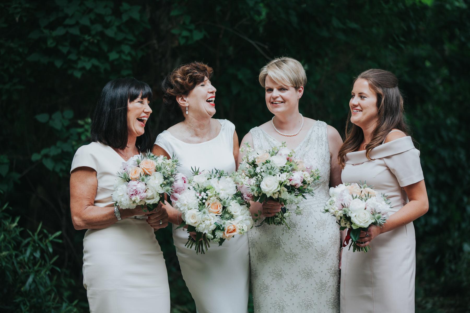 159 bridal party laughing group shot London.jpg