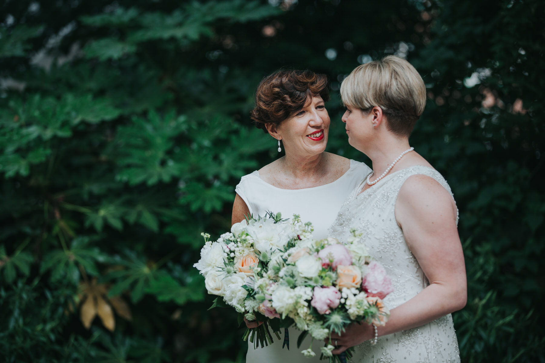 165 two brides looking lovingly couple portraits.jpg